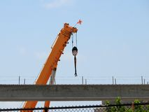 Crane by overpass in construction site, Florida, USA Royalty Free Stock Image