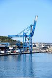Crane in Paola docks, Malta. View of the docks with buildings to the rear, Paola, Malta, Europe Stock Image