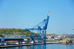 Crane in Paola docks, Malta. View of the docks with buildings to the rear, Paola, Malta, Europe stock photography