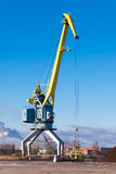 Crane. At peat port on blue sky background Stock Photos