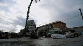 Crane Peel Grabber Destroys a Car for Recycling stock footage