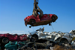Crane picking up car Royalty Free Stock Image