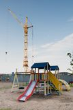 Crane and a playground Stock Photos