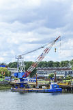 Crane pontoon in Port of Rotterdam. Stock Photos