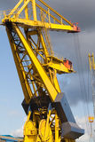 Crane in a port. Crane in a sea industrial freight port. General view Royalty Free Stock Photography
