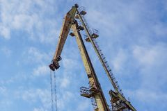 Crane on port. With blue sky in background Royalty Free Stock Photos
