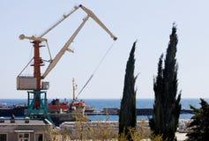 Crane in port. Crane in the cargo port of Yalta Stock Image