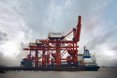 Crane at the port. The crane is lifting cargo at the port Stock Photo