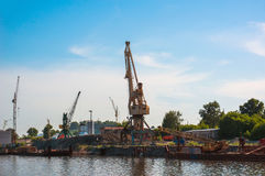 Crane in the port. The construction of the promenade on the seafront Royalty Free Stock Images