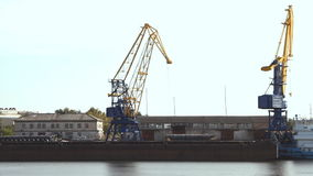 Crane in the port. Moves loads stock footage