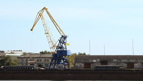 Crane in the port. Moves loads stock video