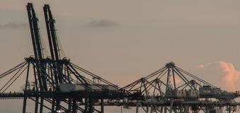 Crane in port. Thailand with sunset Royalty Free Stock Image