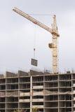 Crane raised formwork on construction of multi storey residential building Stock Image
