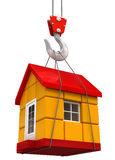 Crane raises House (clipping path included) Stock Photo