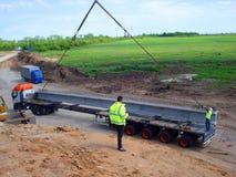 Big concrete beam on truck stock photos