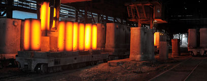 The crane removes forms from the heated steel pigs Stock Images