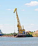 Crane river with barge Royalty Free Stock Photos