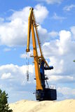 The crane in the river port. Royalty Free Stock Images
