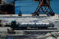 Crane in river port. Heavy cranes unloading metal to import. Steel delivery stock photo