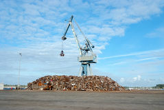 Crane and rubble mountain Royalty Free Stock Images