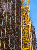 Crane and scaffolding Stock Image