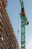 Crane with scaffolding Stock Photo