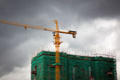 Crane and scaffolding with netting Royalty Free Stock Images