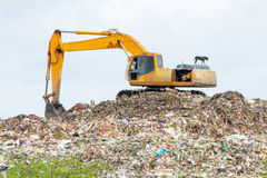 Crane scooping garbage Royalty Free Stock Photo