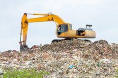 Crane scooping garbage Royalty Free Stock Photo