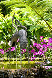 Crane Sculpture in Orchid Garden Stock Images