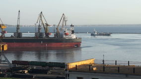 Crane seaport boat. Cargo ship moving load at port. Time lapse stock video