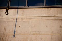 Crane shadow on industrial building. Crane hook shadow on industrial building Royalty Free Stock Images