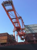 Crane and Shipping Containers Royalty Free Stock Photos