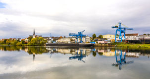 Crane and shipyard at the river Main in Erlenbach Royalty Free Stock Photos