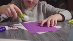 Girl`s hands glueing a card. Valentine`s Day stock video footage