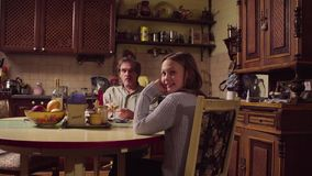 Grandpa and granddaughter talking in the kitchen
