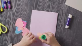 Girl`s hands glueing a card. Valentine`s Day stock footage