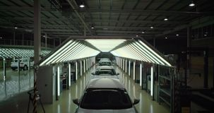 Crane shot: Vehicle inspection line in car factory