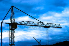 Crane. Silhouette crane on a background of clouds Stock Photo