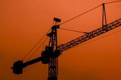 Crane Silhouette och solnedgångljus Arkivfoton