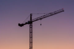 Crane Silhouette over Purple Sky Stock Images
