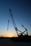 Crane silhouette at sunset Stock Photos