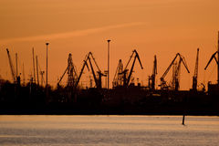 Crane silhouettes. Silhouettes of the cranes at the harbor Royalty Free Stock Images