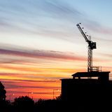 Crane Sillhouette at Sunset. A construction crane silhouetted at sunset. (square frame stock images