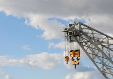 Crane in the sky. Crane used near the harbor ...a touch of yellow against a pale sky Royalty Free Stock Image
