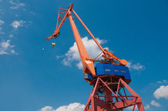 The crane and the sky on background. The vertical picture of the crane with the sky on background stock photo