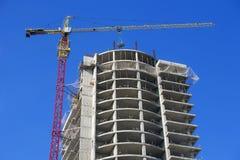 Crane and skyscraper. Royalty Free Stock Photo