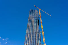 Crane on skyscraper building site. Highest office building in Vienna, Austria, 22nd district Royalty Free Stock Images