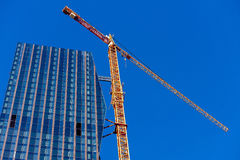 Crane on skyscraper building site. Highest office building in Vienna, Austria, 22nd district Stock Image