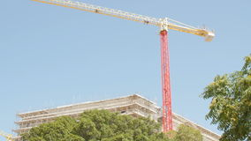 Crane at a skyscraper construction. stock footage